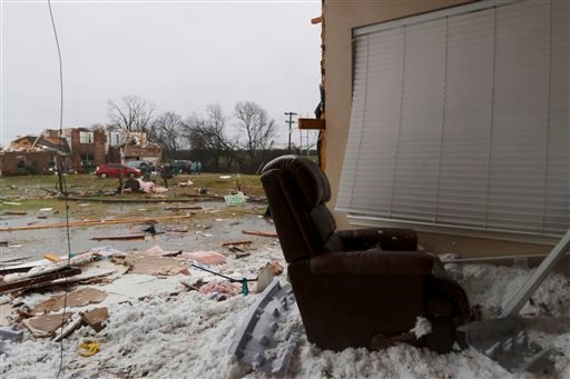 A comfort chair is seen at the site of a residence whose wall was blown away by Saturday night's tornado in Copeville, Texas, Sunday, Dec. 27, 2015. Tornadoes that swept through the Dallas area caused substantial damage and at least 11 people died either