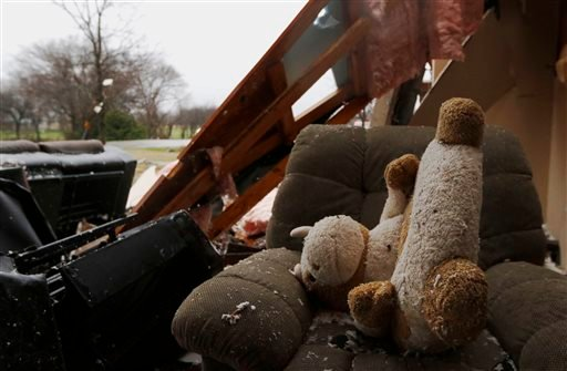 A stuffed animal sits on a comfort chair inside a house destroyed by Saturday night's tornado in Copeville, Texas, Sunday, Dec. 27, 2015. Tornadoes that swept through the Dallas area caused substantial damage and at least 11 people died either from the st