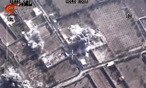 This image made from video made available on Saturday, Dec. 26, 2015, by Al-Mayadeen, government-controlled Syrian Television, which has been verified and is consistent with other AP reporting shows, drone footage allegedly showing Syrian army airstrikes