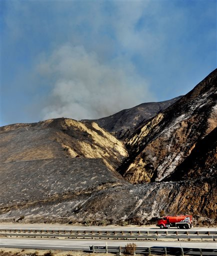 Close Window Photo Details Save Email Print History Photo |Caption|Summary Showing 5 of 13 previous  :  more   Copyright 2015, The Associated Press  Caption   Smoke rises over a hill along Highway 101 in Ventura, Calif., Saturday, Dec. 26, 2015. A wind-wh
