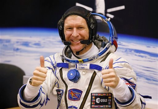 In this Tuesday, Dec. 15, 2015 file photo, British astronaut Tim Peake, member of the main crew of the expedition to the International Space Station (ISS), gestures prior the launch of Soyuz TMA-19M space ship at the Russian leased Baikonur cosmodrome, K