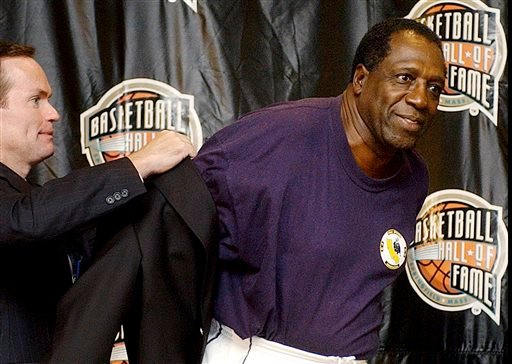 In this Sept. 5, 2003, file photo, Basketball Hall of Fame CEO John Doleva, left, presents a Hall of Fame jacket to inductee Meadowlark Lemon, of the Harlem Globetrotters, at the Basketball Hall of Fame in Springfield, Mass.