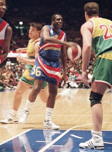In this Feb. 13, 1993, file photo, legendary Harlem Globetrotters' Meadowlark Lemon prepares to put the moves on Washington Generals' Tim Burkhart during their basketball game at Madison Square Garden in New York.