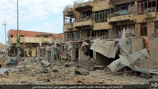This image posted online Sunday, Dec. 27, 2015, by supporters of the Islamic State militant group on an anonymous photo sharing website, shows heavy damage in Ramadi, Iraq, a day before Iraqi forces backed by U.S.-led airstrikes, re-took the government co