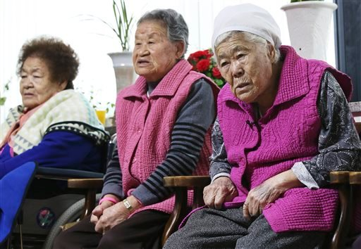 Former South Korean sex slaves, who were forced to serve for the Japanese Army during World War II, wait for results of a meeting of South Korean and Japanese foreign ministers at the Nanumui Jip, The House of Sharing, in Gwangju, South Korea, Monday, Dec