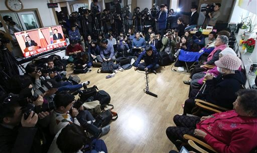 Former South Korean sex slaves, right, who were forced to serve for the Japanese Army during World War II, watch a live broadcast of a joint press conference of South Korean and Japanese foreign ministers at the Nanumui Jip, The House of Sharing, in Gwang