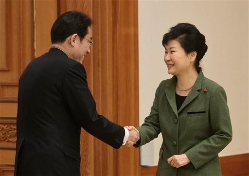 South Korean President Park Geun-hye, right, shakes hands with Japanese Foreign Minister Fumio Kishida prior to a meeting at the presidential house in Seoul, South Korea, Monday, Dec. 28, 2015. The foreign ministers of South Korea and Japan said they had