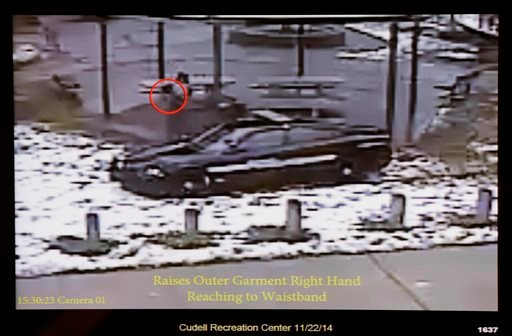 This Nov. 26, 2014 file photo shows a still image taken from a surveillance video recorded on Nov. 22, 2014, that was played at a news conference held by Cleveland Police. It shows Cleveland police officers arriving at Cudell Park on a report of a man wit