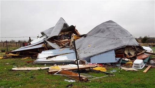 This Sunday, Dec. 27, 2015 photo shows damage to the home where Daniel and Zuleyma Santillano lived with their newborn and three older children in Blue Ridge, Texas, north of Dallas. (AP Photo/Reese Dunklin)