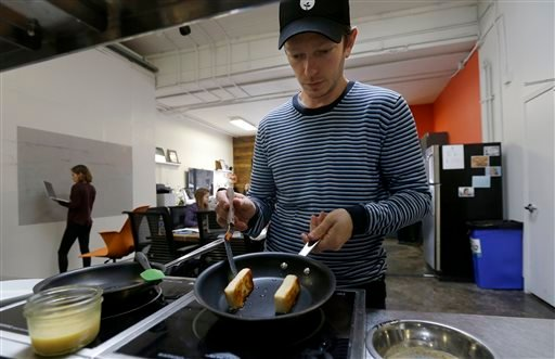 In this Feb. 4, 2015 photo Hampton Creek Foods pastry chef Ben Roche preparing french toast made with Just Scramble at their office in San Francisco.