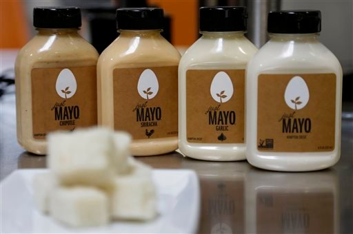 This Feb. 4, 2015 photo shows Hampton Creek Foods bottles of Just Mayo flavors at their office in San Francisco. Hampton Creek's mission is to replace the eggs in products without anyone noticing.