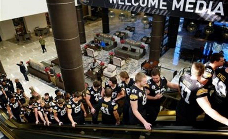 The Iowa football team arrives for Media Day at The L.A. Downtown Hotel in Los Angeles on Tuesday, Dec. 29, 2015. Iowa is scheduled to play Stanford in the Rose Bowl NCAA college football game on New Year's Day. (AP Photo/Richard Vogel)