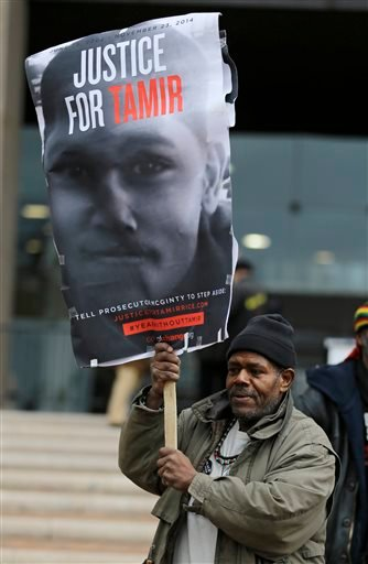 Charles Freeman protests outside the Cuyahoga County Justice Center, Tuesday, Dec. 29, 2015, in Cleveland. People marched peacefully in front of the Justice Center in downtown Cleveland to protest a grand jury's decision not to indict two white Cleveland