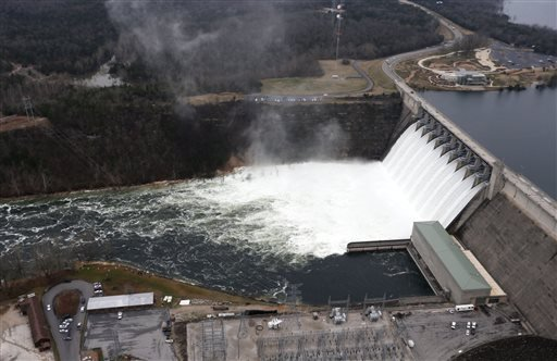 In this Tuesday, Dec. 29, 2015 photo, Table Rock Lake Dam in Branson, Mo. was releases water from it's ten spillway gates.
