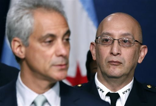 Chicago Police Superintendent John Escalante, right, listens to Chicago Mayor Rahm Emanuel during a news conference about new police procedures on Wednesday, Dec. 30, 2015, in Chicago. Emanuel says every Chicago police patrol car will be equipped with a T