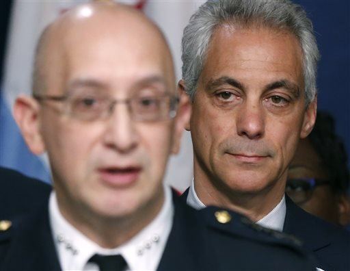 Chicago Mayor Rahm Emanuel, right, listens to Police Superintendent John Escalante during a news conference about new police procedures on Wednesday, Dec. 30, 2015, in Chicago. Emanuel says every Chicago police patrol car will be equipped with a Taser fol