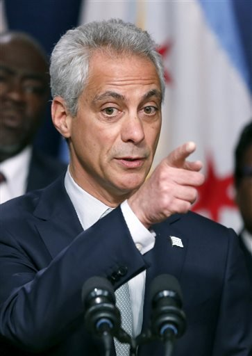 Chicago Mayor Rahm Emanuel responds to a question during a news conference about new police procedures on Wednesday, Dec. 30, 2015, in Chicago. Emanuel says every Chicago police patrol car will be equipped with a Taser following a series of high-profile s