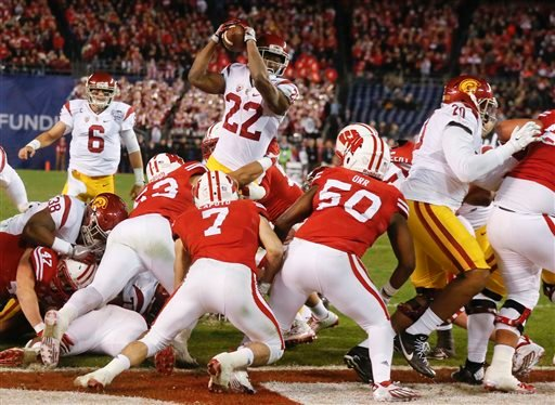 Southern California running back Justin Davis (22) scores a touchdown during the first half of the Holiday Bowl NCAA college football game against Wisconsin on Wednesday, Dec. 30, 2015, in San Diego. (AP Photo/Lenny Ignelzi)