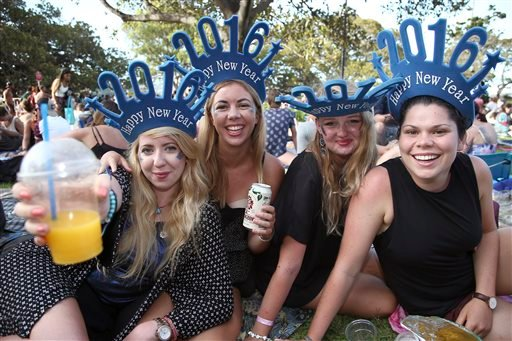 Women celebrate the coming of a new year as they wait for the annual New Years Eve fireworks display in Sydney, Australia, Thursday, Dec. 31, 2015. (AP Photo/Rob Griffith)