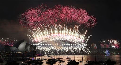 Fireworks explode over the Opera House and Harbour Bridge during New Year's Eve fireworks display in Sydney, Australian, Friday, Jan. 1, 2016.(AP Photo/Rob Griffith)