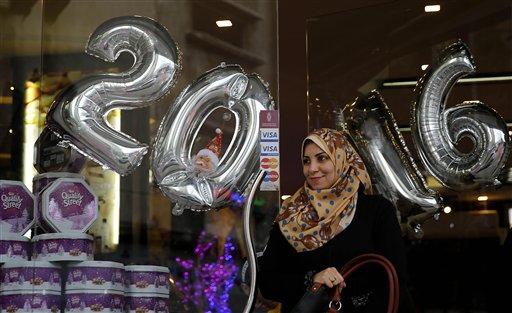 Palestinian women shop on the last day of 2015 in Gaza city, Thursday, Dec. 31, 2015. (AP Photo/Hatem Moussa)