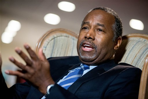 In this Dec. 23, 2015 file photo, Republican presidential candidate Dr. Ben Carson speaks in his home in Upperco, Md. Two of Carson's top paid advisers are leaving the campaign with only a month to go before Iowa's leadoff caucuses. That's according to Ca