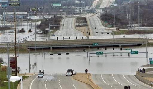 Floodwater from the Meramec River surround the bridge deck of I-44 and Highway 141 in southwest St. Louis County, Wednesday, Dec. 30, 2015. (J.B. Forbes/St. Louis Post-Dispatch via AP)