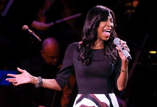 "Monday, March 2, 2015 file photo, singer Natalie Cole performs at ""An Evening of SeriousFun Celebrating the Legacy of Paul Newman,"" at Avery Fisher Hall, in New York. Photo by Evan Agostini/Invision/AP, File)"