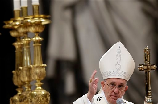 Pope Francis delivers a blessing at the end of a New Year mass in St. Peter's Basilica at the Vatican, Friday, Jan. 1, 2016. (AP Photo/Gregorio Borgia)