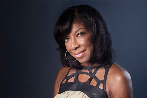 "FILE- In a Wednesday, June 26, 2013 file photo, Grammy winning singer-songwriter Natalie Cole poses for a portrait in promotion of her new album ""Natalie Cole en Espanol,"" in New York. (Photo by Victoria Will/Invision/AP, File)"