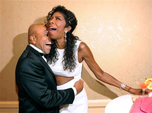 FILE - In a Saturday, Oct. 11, 2014 file photo, Motown Records founder Berry Gordy, left, embraces singer Natalie Cole at the 2014 Carousel of Hope Ball at the Beverly Hilton Hotel, in Beverly Hills, Calif. (Photo by Chris Pizzello/Invision/AP, File)