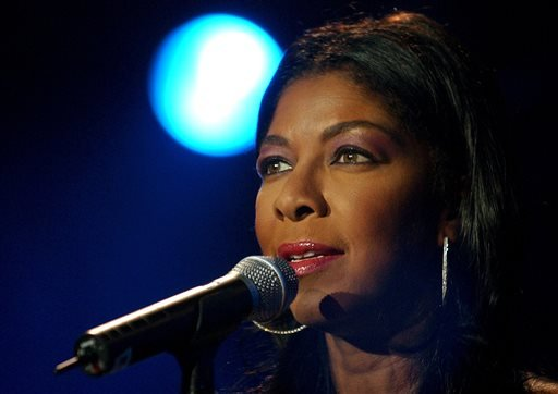 FILE - In a Sunday, July 6, 2003 file photo, singer Natalie Cole performs on Stravinsky stage, during the 37th Montreux Jazz Festival, in Montreux, Switzerland. (AP Photo/ Keystone, Martial Trezzini, File)