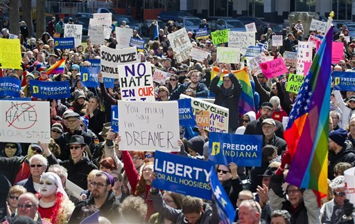 FILE - In this March 28, 2015, file photo, opponents of an Indiana religious objections law rally outside the State House in Indianapolis. (AP Photo/Doug McSchooler, File)