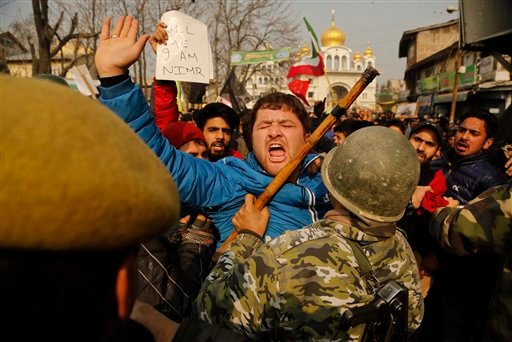 A Kashmiri Shiite Muslim shouts slogans as police stop them during a protest against Saudi Arabia in Srinagar, Indian controlled Kashmir, Sunday, Jan. 3, 2016. Indian police used tear smoke and rubber bullets to disperse Shiite Muslims who were protesting