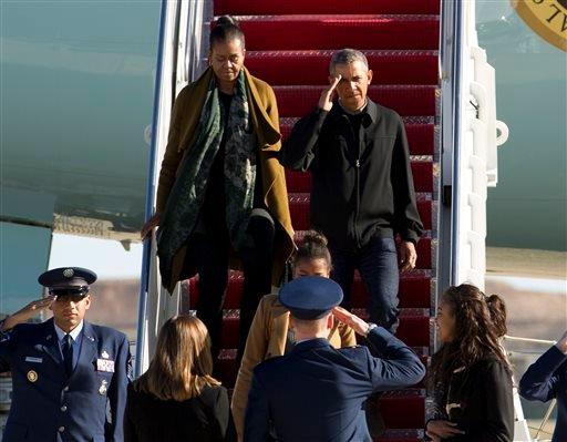President Barack Obama, first lady Michelle Obama and their daughters Sasha and Malia arrive at Andrews Air Force Base, Md., Sunday, Jan. 3, 2016, as they return from vacation in Hawaii. (AP Photo/Jose Luis Magana)