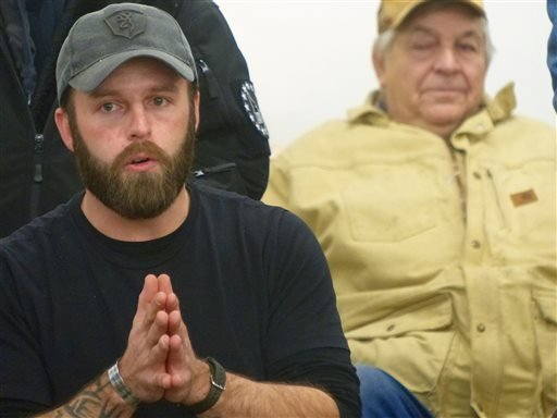 Ryan Payne, an Army veteran from Montana, participates in a community meeting in Burns, Ore., on Friday, Jan. 1, 2016. He was among key militiamen who seized control of the Malheur National Wildlife Refuge after a peaceful protest parade in Burns on Satur
