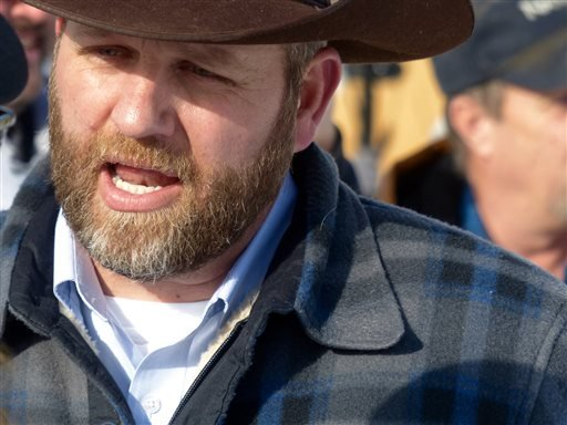 Ammon Bundy chats with a protester Saturday, Jan. 2, 2016, during a march on behalf of a Harney County ranching family in Burns, Ore. Bundy, the son of Nevada rancher Cliven Bundy, who was involved in a standoff with the government over grazing rights, to