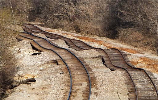 Railroad tracks, running under Interstate 44 in Eureka, Mo., near Route 66 State Park, that were undermined by floodwaters from the Meramec River and are visible on Friday, Jan. 1, 2016. The worst of the dangerous, deadly winter flood is over in the St. L