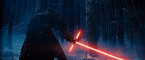 """This photo provided by Disney shows, Adam Driver as Kylo Ren with his Lightsaber in a scene from the new film, """"Star Wars: The Force Awakens."""" (Film Frame/Disney/Copyright Lucasfilm 2015 via AP)"""