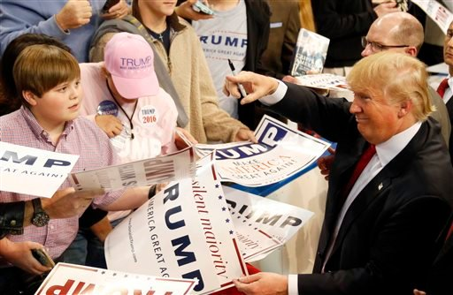 Republican presidential candidate Donald Trump gestures towards a supporter after speaking during a rally in Biloxi, Miss., Saturday, Jan. 2, 2016. (AP Photo/Rogelio V. Solis)