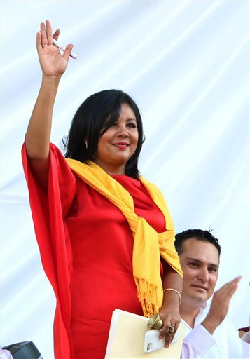 In this Friday, Jan. 1, 2016 photo, Gisela Mota waves during her swearing in ceremony as mayor of Temixco, Morelos State, Mexico. The Morelos state Public Security Commission says attackers invaded Mota's house on Saturday morning and killed her. (AP Phot