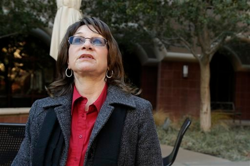 Dec. 29, 2015, photo, the Inland Regional Center's executive director, Lavinia Johnson, pauses for a moment during an interview with The AP on the campus of the regional center where the attack on Dec. 2 took place in San Bernardino, Calif. (AP Photo/ Nic