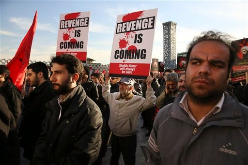 Iranian demonstrators hold anti-Saudi placards in a rally to protest the execution by Saudi Arabia last week of Sheikh Nimr al-Nimr, a prominent opposition Saudi Shiite cleric, in Tehran, Iran, Monday, Jan. 4, 2016. Allies of Saudi Arabia followed the kin