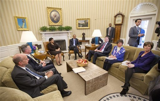 President Barack Obama meets with top law enforcement officials in the Oval Office of the White House in Washington, Monday, Jan. 4, 2016, to discuss executive actions the president can take to curb gun violence. The president is slated to finalize a set