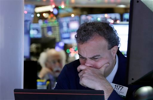 Trader Gerard Farco works on the floor of the New York Stock Exchange, Monday, Jan. 4, 2016. U.S. stocks are opening 2016 on a grim note, dropping sharply after a plunge in China and declines in Europe. (AP Photo/Richard Drew)