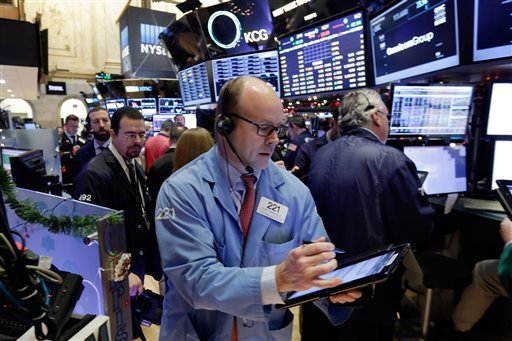 Trader Peter Mancuso, center, works on the floor of the New York Stock Exchange, Monday, Jan. 4, 2016. U.S. stocks are opening 2016 on a grim note, dropping sharply after a plunge in China and declines in Europe. (AP Photo/Richard Drew)