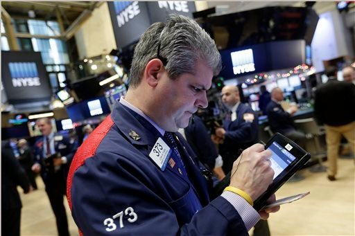 Trader John Panin works on the floor of the New York Stock Exchange, Monday, Jan. 4, 2016. U.S. stocks are opening 2016 on a grim note, dropping sharply after a plunge in China and declines in Europe. (AP Photo/Richard Drew)