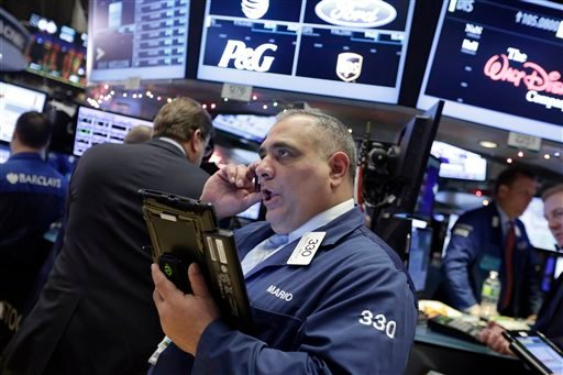 Trader Mario Innella works on the floor of the New York Stock Exchange, Monday, Jan. 4, 2016. U.S. stocks are opening 2016 on a grim note, dropping sharply after a plunge in China and declines in Europe. (AP Photo/Richard Drew)