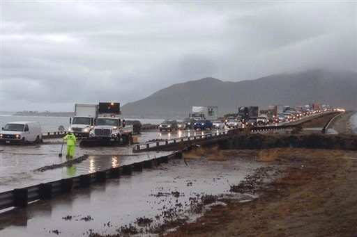 Portions of the 101 freeway in Ventura flood due to rain on Tuesday, Jan. 5, 2016, in Ventura, Calif. Persistent wet conditions could put some Los Angeles County communities at risk of flash flooding along with mud and debris flows, especially in wildfire
