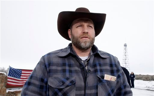 Ammon Bundy, one of the sons of Nevada rancher Cliven Bundy, speaks during an interview at Malheur National Wildlife Refuge, Tuesday, Jan. 5, 2016, near Burns, Ore. Law enforcement had yet to take any action Tuesday against a group numbering close to two